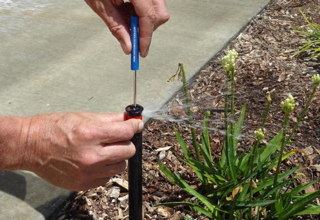 how to change sprinkler spray radius